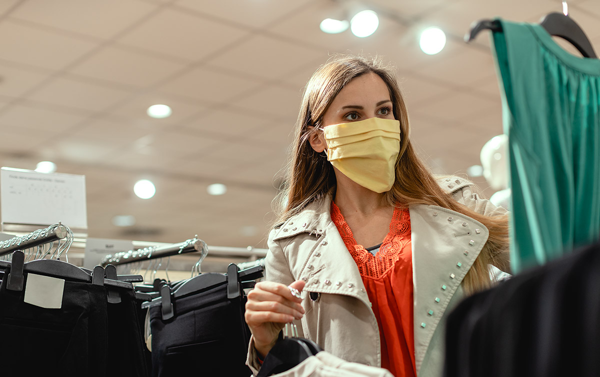 Woman shopping with face mask